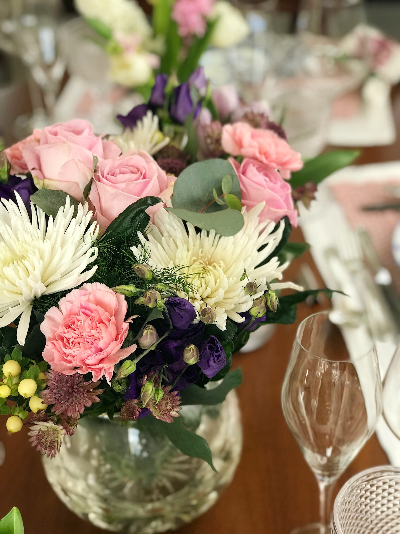A beautiful tablescape created from a pink purple and white bouquet it has light pink roses rose carnations purple lisianthus white aster eucalyptus leaves and a pretty tine violet flowers i dont know the name mightylinksfo